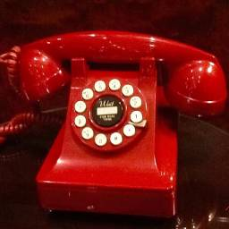 retro red vintage telephone shiny